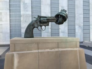 Sculpture of a gun with the barrel twisted in a knot